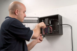 Man installing video security system