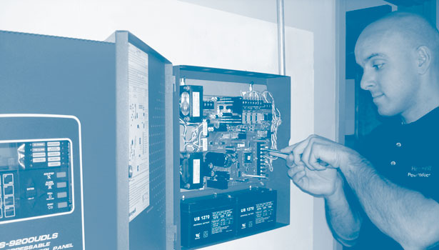 Technican working on a fire alarm panel