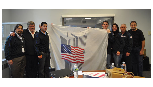 Diebold employees with commemorative flag