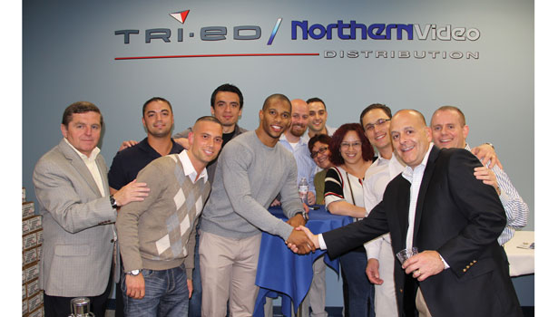 New York Giants wide receiver Victor Cruz shakes the hand of Tri-Ed / Northern Video President and CEO Pat Comunale