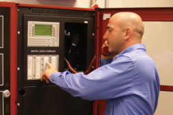 Man operating fire alarm system