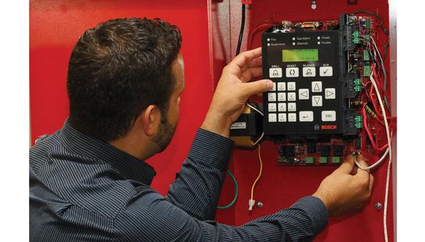 Standard Installation Fire Alarm Systems Man Installing Fire Alarm