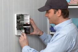 Man installing alarm system