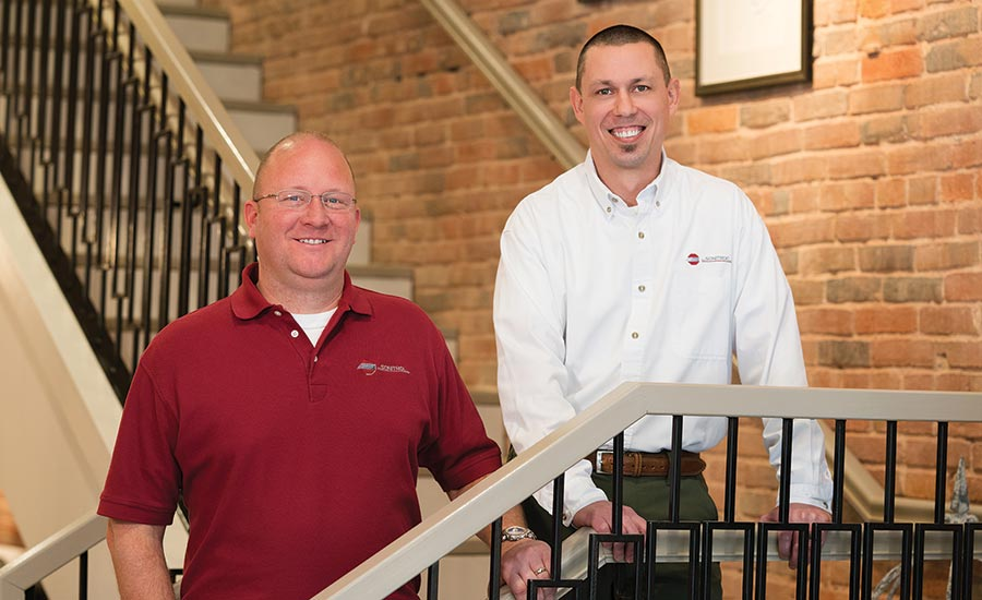 Sonitrol of Evansville's Chris Dingman (right) and security consultant Andrew Beitler visit a customer's business