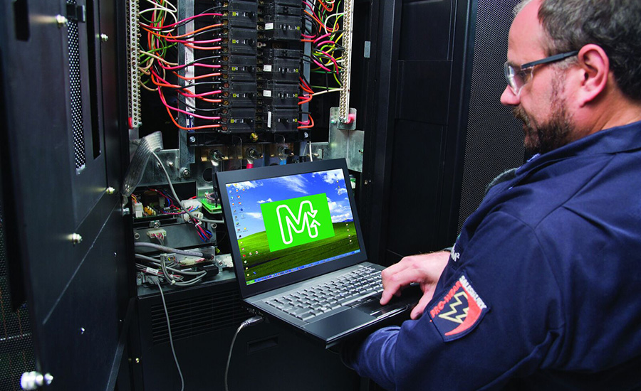 schneider guy in data center looking at monitor