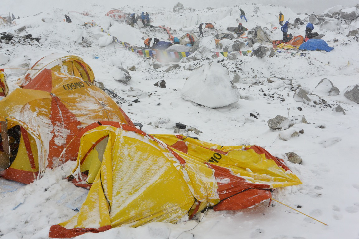 The same camp, after the powerful avalanche hurled d ice, rocks, and snow on the tents.