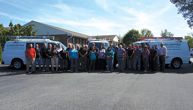 This team photo, taken at Unlimited Technology's corporate headquarters in Chester Springs, Pa.