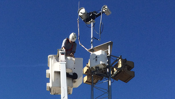 An Unlimited Technology technician installs radar and a long-range camera as part of a critical infrastructure project.