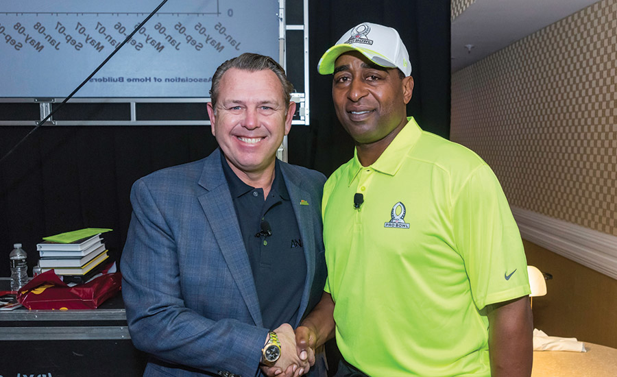NFL Hall of Fame Member and 2015 Pro-Bowl Co-Captain Chris Carter shakes hands with AiN Group president Stan Matysiak.