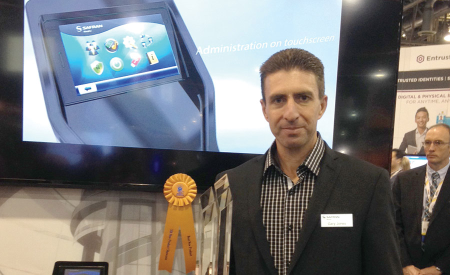 Safran Morpho's Gary Jones poses with the trophy his company won for Best New Product in the New Product Showcase Awards Program at ISC West.