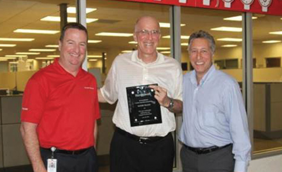 Honeywell's Scott Harkins, Roger Fradin and Ron Rothman (left to right) celebrate 1 million AlarmNet users in 2012. PHOTO COURTESY OF HONEYWELL