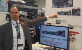 Thomas Cook demonstrates Samsungâ??s new IP surveillance kits during ISC West. PHOTO BY SDM STAFF