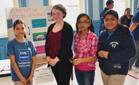Students from Chase Elementary in Chicago demonstrate their knowledge about alternate energy vehicles at a community event.